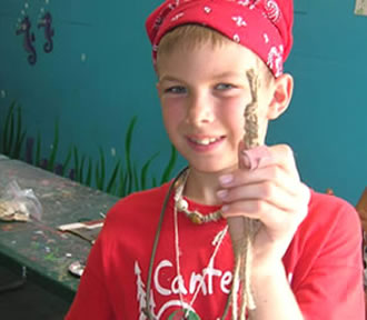 Boy holding friendship bracelet